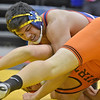 (Brad Davis/The Register-Herald) Independence's Noah Adams takes on Wirt's Mike Burns in the 220-pound weight class championship match at the 70th Annual WVSSAC State Wrestling Tournament Saturday night at the Big Sandy Arena in Huntington.
