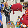 (Brad Davis/The Register-Herald) Cary Caldwell, right, checks out a beanbag crab as volunteer J.D. Monroe (13), an Independence Middle School student who came all the way from Coal City to help out, ponders the strange, squishy toys during the Wyoming County Toy Fund Sunday morning at Wyoming East High School.
