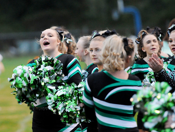 Fayetteville High School cheerleaders cheer as their football team takes the field prior to kickoff of their game against Meadow Bridge Friday in Meadow Bridge. (Chris Jackson/The Register-Herald)