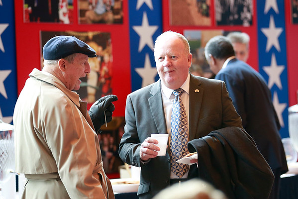 Dave Perry (D-Fayette) speaks with former West Virginia Representative John Doyle from Jefferson County, during a reception at The Cultural Center Monday.