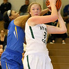 (Brad Davis/The Register-Herald) Wyoming East's Emily Saunders keeps the ball out of the reach of St. Joseph Central's Kendra Ziegler underneath as she looks for an open teammate during the Lady Warriors' win over the Irish Friday night in New Richmond.