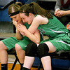 (Brad Davis/The Register-Herald) Fayetteville teammates Mallory Hendrick, left, and Hannah Franklin comfort each other during the closing moments of the Pirates' season-ending loss to Summers County Thursday night in Hinton.