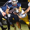 (Brad Davis/The Register-Herald) Independence's Robbie Cochran carries the ball as Clay County defender Zach Ferebee tries to bring him down Friday night in Coal City.