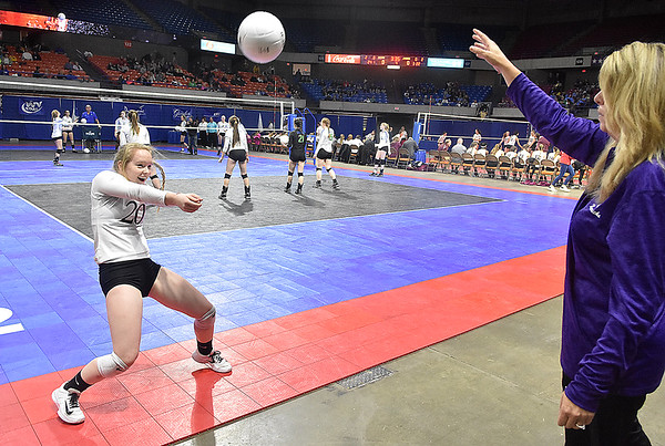 (Brad Davis/The Register-Herald) James Monroe assistant coach Julie Bailey challenges libero Kelli Ellison during warm ups prior to their afternoon match against Robert C. Byrd during State Volleyball Tournament action Friday afternoon at the Charleston Civic Center.