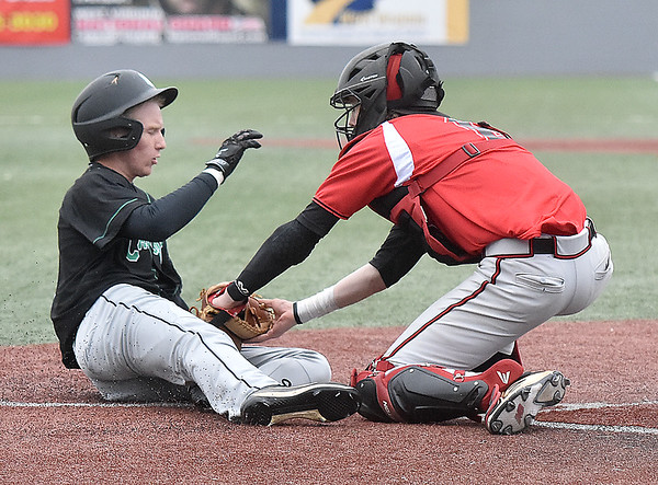 (Brad Davis/The Register-Herald) Greater Beckley Christian catcher Brett Riffe makes the tag and gets the out on Charleston Catholic's Nick Wentz as he tries to score Thursday afternoon at Linda K. Epling Stadium.