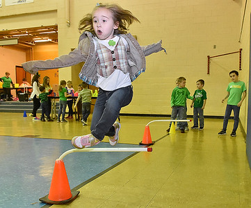 (Brad Davis/The Register-Herald) Kindergartener Rylei Burgess catches some big air as she clears obstacles during Maxwell Hill Elementary's Jumping for Hearts event Friday afternoon in the school's gymnasium. Students spent several days gathering donations for the American Heart Association by sending out e-mails, asking friends and family or even going door-to-door in their neighborhoods if they wised, raising around $5,000 overall. The annual event concluded with a special celebration in the gym where students got to run and play in a variety of jumping-related activities.