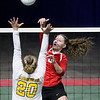 (Brad Davis/The Register-Herald) Greater Beckley Christian's Abigail Hill rushes in to send the ball back over as Moorefield's Lindsey Rinker tries to block it during State Volleyball Tournament action Friday afternoon at the Charleston Civic Center.