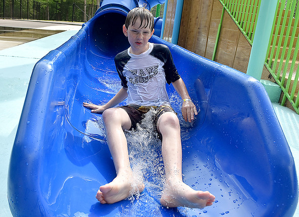 (Brad Davis/The Register-Herald) 12-year-old Isaac Conaway races down one of the slides inside the Spalsh Park at Lake Stephens Saturday afternoon.