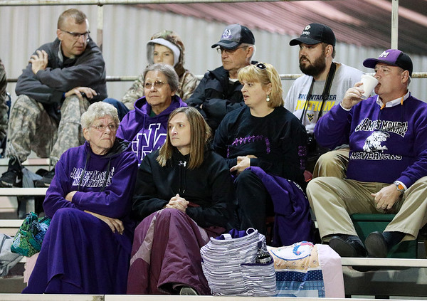James Monroe fans keep arm as they watch their side play Nicholas County Friday in Summersville. (Chris Jackson/The Register-Herald)