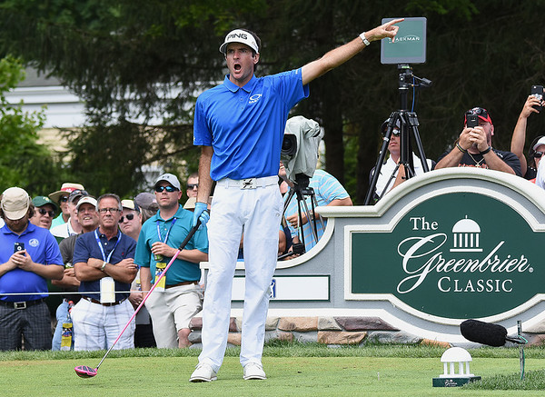 Bubba Watson points to the left after hitting his tee shot on the 12th hole during the third round of The Greenbrier Classic.<br /> (Rick Barbero/The Register-Herald)