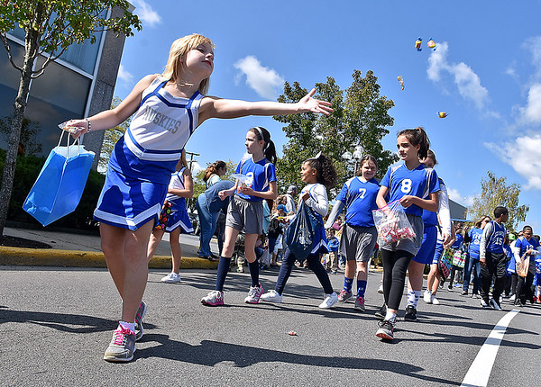 (Brad Davis/The Register-Herald) Youngsters from Stanaford Elementary toss candy to their fellow youths during the Kids Classis Festival Parade Saturday morning in Beckley.