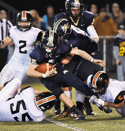 Nicholas County's Jacob O'Dell is tackled by Richwood's Will Bragg (6) and Hunter Amick  (55) during their high school football game Friday in Summersville. (Chris Jackson/The Register-Herald)