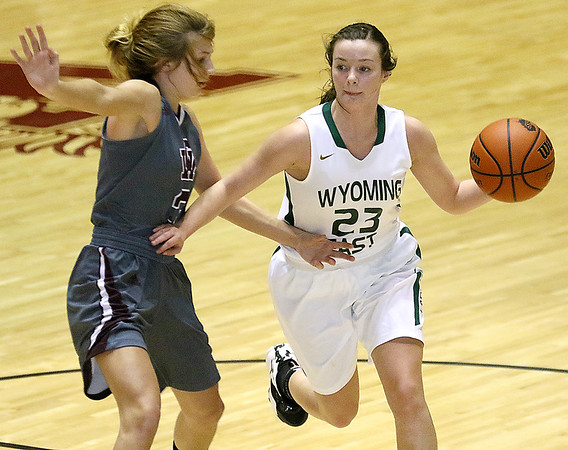 (Brad Davis/The Register-Herald) Wyoming East's Katie Daniels moves the ball up the court as George Washington's Sydney Mallory defends during Big Atlantic Classic action Wednesday night at the Beckley-Raleigh County Convention Center.