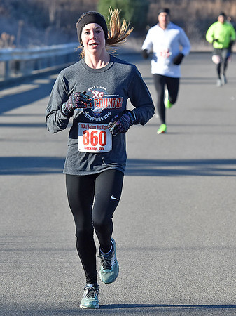 (Brad Davis/The Register-Herald) Top female finisher Adriana Cook makes her way down the home stretch during the YMCA of Southern West Virginia's annual Turkey Trot 5K Walk/Run on a chilly Thanksgiving morning Thursday at the YMCA Paul Cline Memorial Sports Complex.