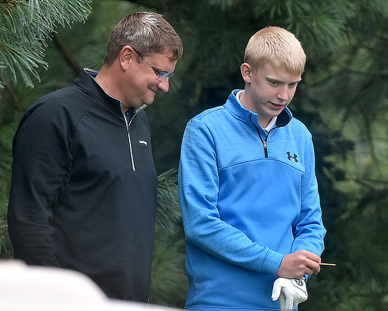 (Brad Davis/The Register-Herald) Dad Chris and son Nathan Daniels talk prior to a tee shot during BNI action Saturday afternoon at Grandview Country Club.
