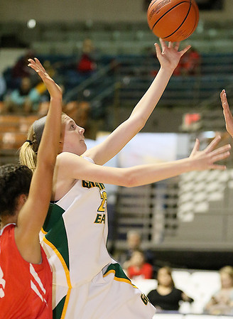 (Brad Davis/The Register-Herald) Greenbrier East's Haley McClure goes for a layup as Parkersburg's Breanna Wilson defends during Big Atlantic Classic action Saturday afternoon at the Beckley-Raleigh County Convention Center.