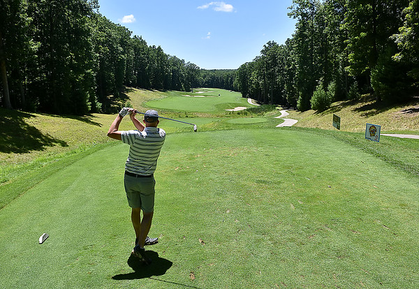 (Brad Davis/The Register-Herald) Jonathan Forren tees off into the lovely scenery of the 16th hole during BNI action Sunday afternoon at Glade Springs' Stonehaven Golf Course.