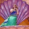 (Brad Davis/The Register-Herald) Ariel, played during select performances by Farrah Ahmed, sits perched inside a sea shell during a scene from Woodrow Wilson High School's rendition of Disney's The Little Mermaid Friday afternoon inside the school's auditorium.