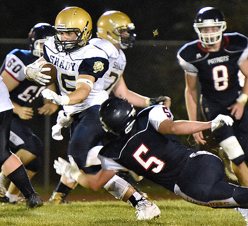 (Brad Davis/The Register-Herald) Shady Spring's Tyler Bragg rumbles ahead as Independence's Haegan Harvey dives to try and stop him Friday night in Coal City.