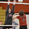 (Brad Davis/The Register-Herald) Liberty's Erin Stone, left, blocks a spike from PikeView's Hope Craft during a volleyball match at Liberty High School October 11.
