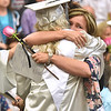 (Brad Davis/The Register-Herald) Kristy Fleenor gets a rose and hug from her daughter and graduating Westside senior Alysson Fleenor during the flower ceremony prior to the school's 2017 Commencement Sunday afternoon in Clear Fork.