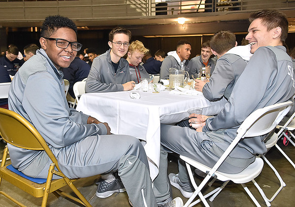 (Brad Davis/The Register-Herald) Independence's Marcell Guy, far left, and his amused teammate Kyle Saunders, far right, at the Patriots' table during the Big Atlantic Classic Tip-Off Banquet Sunday afternoon at the Beckley-Raleigh County Convention Center.