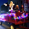 (Brad Davis/The Register-Herald) Santa waves to the crowd as he rolls along Main Street during the annual Oak Hill Christmas Parade Saturday evening.