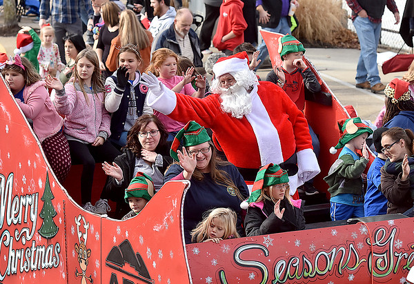 (Brad Davis/The Register-Herald) Santa waves to the crowd during Beckley's annual Christmas Parade Saturday afternoon.