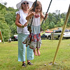 (Brad Davis/The Register-Herald) Jumping Branch resident Wilma Lilly pushes her granddaughter, 5-year-old Niantic, Connecticut resident Madeline Rodes on a swing during the annual Lilly Family Reunion Saturday afternoon. It was Madeline's first ever trip to West Virginia along with two older sisters.
