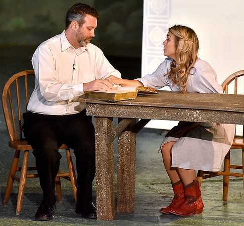 (Brad Davis/The Register-Herald) Ariel (right), played by Molly Ann Ross, and dad Rev. Moore, played by Jamie Rogers, have a heart to heart talk during a scene from Theatre West Virginia's Footloose at Grandview Park's Cliffside Amphitheatre.