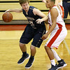 (Brad Davis/The Register-Herald) Greenbrier West's Landon Humphreys looks for an open teammate as he's guarded by Independence's Niko Burgess Friday night in Coal City.