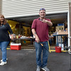 (Brad Davis/The Register-Herald) Property manager Michelle Bennett, left, and leasing agent Phil Spurlock notice the camera as they grill hotdogs during a community picnic at Greenbrier Estates Friday afternoon.