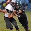 (Brad Davis/The Register-Herald) Westside's Dalton Estep is caught and tackled by Wyoming East's Wyoming East's Jake Cannady Friday night in New Richmond.
