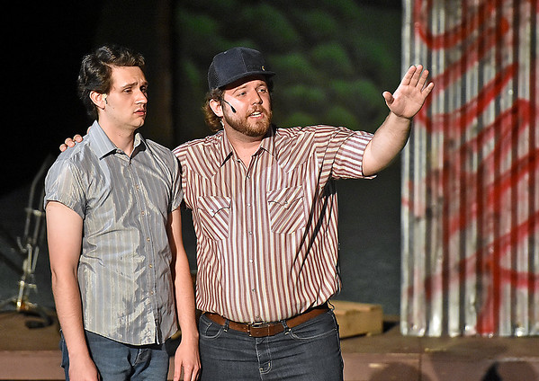 (Brad Davis/The Register-Herald) Ren (left), played by Holden Akers-Toler, is encouraged by friend Shere Khan, played by Brooks Cline, during a scene from Theatre West Virginia's Footloose at Grandview Park's Cliffside Amphitheatre.