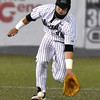 (Brad Davis/The Register-Herald) Marshall shortstop Leo Valenti charges in to scoop up a ground ball during the second game of Saturday's doubleheader against Florida International at Linda K. Epling Stadium.