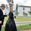 (Brad Davis/The Register-Herald) Alfred Beckley, a.k.a. Jerry Godfrey, and Jane Beckley, a.k.a. Brenda Burgess make their way back to the ground of Wildwood House to join in the festivities during Founders Day Saturday afternoon.