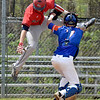 (Brad Davis/The Register-Herald) Independence's Logan Stump tries jump over Princeton catcher Matthew Mitchem but is tagged out mid-air during the Jeff Treadway Memorial Wooden Bat Tournament Saturday afternoon in Coal City.