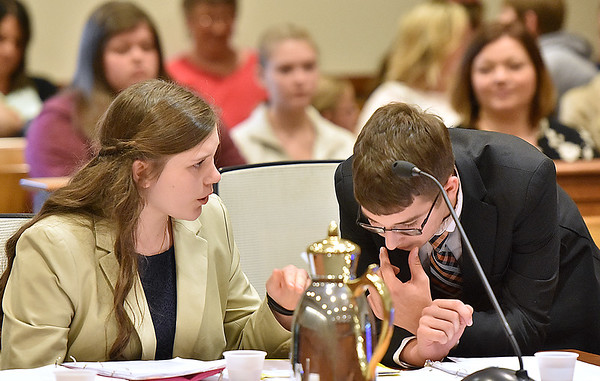 "(Brad Davis/The Register-Herald) ""Prosecuting attorneys"" Kinsley Macin, left, and Nathan Ward consult with one another during a break in the cross examination of a witness during a mock trial with middle and high school-aged homeschoolers from the Appalachian Academy in Raleigh County Ciruit Court Monday afternoon. The students participated in a rehearsed, play-like trial in which they played the various roles of prosecuting attorneys, witnesses, defendants, lawyers and court clerks, with judgement being handed down by Judge Kirkpatrick at the end of the proceedings."