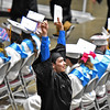(Brad Davis/The Register-Herald) Liberty senior Travis Dunn reacts to cheers from friends and family during the school's 40th Commencement Saturday afternoon at the Beckley-Raleigh County Convention Center.