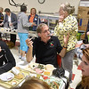 (Brad Davis/The Register-Herald) Richwood mayor Bob Henry Baber, middle, mingles with residents as he enjoys the annual ramp feast Saturday afternoon at Cherry River Elementary School.