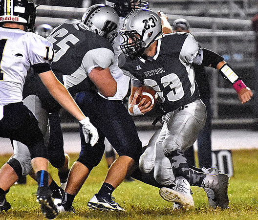 (Brad Davis/The Register-Herald) Westside's Brock Smith carries the ball against Nicholas County Friday night in Clear Fork.