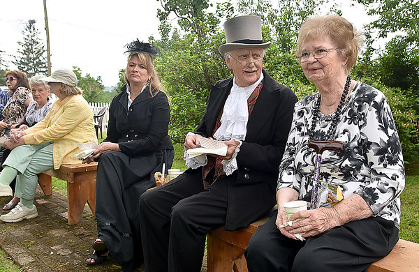 (Brad Davis/The Register-Herald) June Truax, far right, the 3rd Great Granddaughter of Alfred Beckley, takes in the atmosphere with Jerry Godfrey as Alfred and Brenda Burgess as Jane Beckley in the back yard of Wildwood House during Founders Day Saturday afternoon.