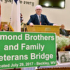(Brad Davis/The Register-Herald) Jeffrey Almond, son of the late Navy veteran John W. (Bill) Almond, thanks friends and family in attendance shortly after unvieling a special sign declaring the interstate bridge over MacArthur after the Almonds during a dedication ceremony Saturday morning at Hollywood Missionary Baptist Church. Around 28 Almond family members have served in the armed forces over multiple generations with nearly 100 years of combined service.