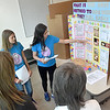 (Brad Davis/The Register-Herald) St. Francis de Sales Catholic School students Adrienne Fink, left, and Elysia Salon make their presentation on the best way to boil eggs so they peel easily during the RESA 1 Regional Science Fair Saturday morning at the Erma Byrd Higher Learning Center. In Case you're intersted, they found that a bamboo steaming method is the best.