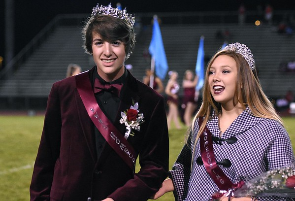 Jarrett Childress, left, and Kennedy Vandyke, Woodrow Wilson, were crowned as king and queen at halftime during game against Hurricane Friday night at Van Meter Stadium in Beckley.<br /> (Rick Barbero/The Register-Herald)