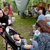 (Brad Davis/The Register-Herald) Nikki Lilly, left, and son Liam Lilly, 8 months, hang out with Sherry Aaron and Janet Richmond during the annual Lilly Family Reunion Saturday afternoon near Ghent.