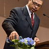 "(Brad Davis/The Register-Herald) Keynote speaker Dr. Geoffrey Cousins, a West Virginia-based heart surgeon and a national pioneer of robotic-assisted heart surgery, leads a special Swahili ceremony in which congregants would say the name or names of loved ones lost, and a small amount of water is poured in their honor as the word ""ashe,"" meaning ""so be it,"" is spoken in unison by the congregation during Heart of God Ministries' Black History Month celebration Sunday evening."
