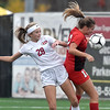 (Brad Davis/The Register-Herald) University's Tristan Bright, left, and Cabell Midland's Ashton Lowe collide mid-air as the two leap for a header at midfield during the Class AAA Girls State Soccer Championship Game Saturday afternoon at the YMCA Paul Cline Memorial Sports Complex.