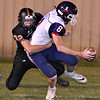 (Brad Davis/The Register-Herald) Independence quarterback Adam Daniels is caught by Summers County pass rusher Trent Meador Friday night in Hinton.