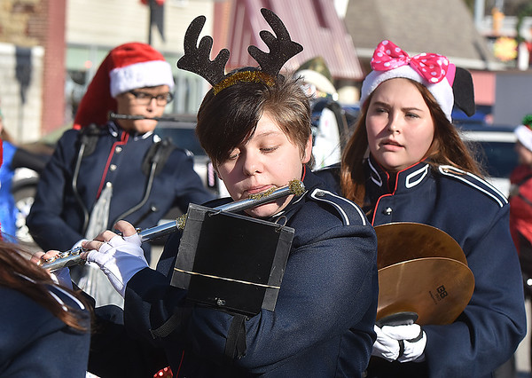 (Brad Davis/The Register-Herald) Festive members of the Independence High School marching band perform as they make their way along Main Street in Sophia during the town's annual Christmas Parade Saturday afternoon.
